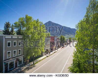 Elk Avenue, the main business district of Crested Butte, Colorado with Crested Butte Mountain in the distance. - Stock Photo