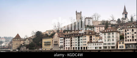 LUCERNE, SWITZERLAND - FEBRUARY 07, 2010: View of Lucerne fortress walls with towers and embankment of the Reuss - Stock Photo