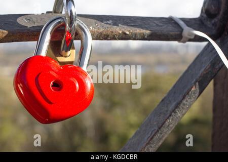 Red locks in the form of a heart. Metal locks. A bunch of locks. Heart locks - Stock Photo