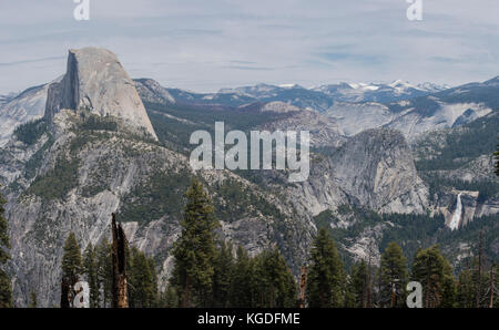 A panoramic view of Half Dome and Nevada Falls from the Panorama Trail in Yosemite National Park. - Stock Photo