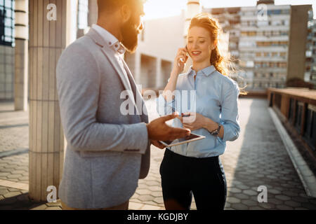 Business colleagues talking on break from work - Stock Photo