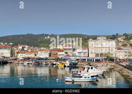 Istanbul, Turkey - April 27, 2017: View of Burgazada island from the sea with summer houses and a small mosque. - Stock Photo