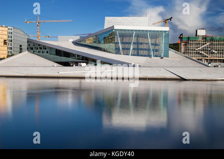 Opera House of Oslo, Norway. Situated in the Bjorvika neighborhood, at the head of the Oslofjord, it was designed - Stock Photo