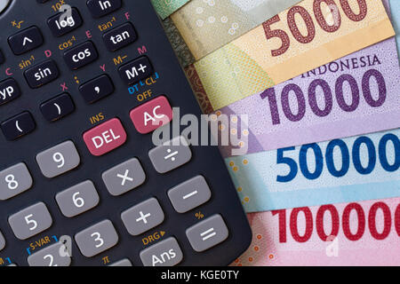 Top view / Flat Lay of Spending money and payments calculation illustrated with money and calculator - Stock Photo