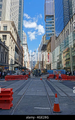 Construction work laying steel rail tracks along George Street in Sydney's CBD (central business district) for the - Stock Photo