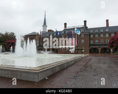 Large American flag hanging on Alexandria City Hall in Alexandria, Virginia, United States. - Stock Photo