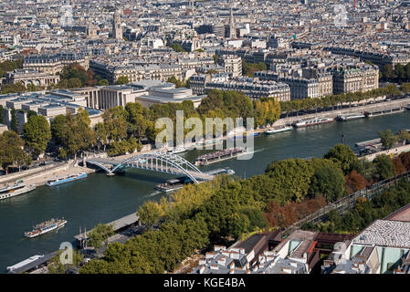 View from the Eiffel Tower looking towards the Passerelle Debilly, a footbridge that connects the quai de New York - Stock Photo