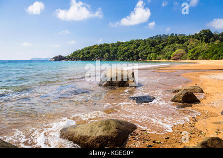 Idyllic empty beach in Tioman island in the South China Sea in Malaysia on a sunny day in Southeast Asia. - Stock Photo
