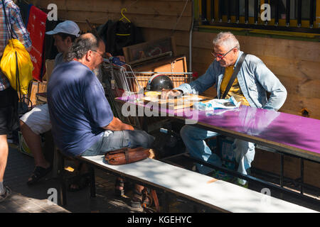 Israel The Holy Land Tel Aviv Jaffa Yafo flea market cafe bar wooden shed benches seats customers drinks glasses - Stock Photo
