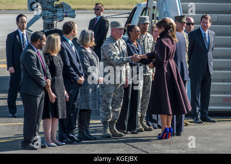 First Lady Melania Trump shakes hands with Col. Kenneth Moss, 374th Airlift Wing commander, before boarding Air - Stock Photo