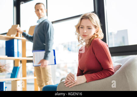 Sad gloomy woman being focused on her thoughts - Stock Photo