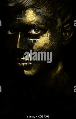 Black and Gold Boy - Stock Photo