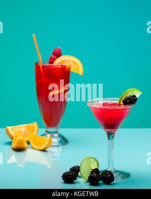 Refreshing fruit cocktails on pastel turquoise background - Stock Photo