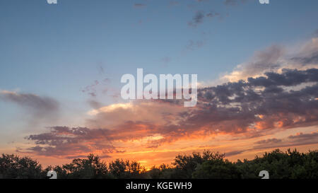 Storm Cloud Moving Left at Sunrise - Stock Photo