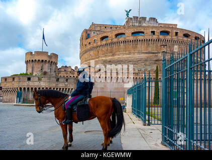Rome, Italy - March 2, 2017: Castel Sant'Angelo: Two policemen on horseback guarding the monument - Stock Photo