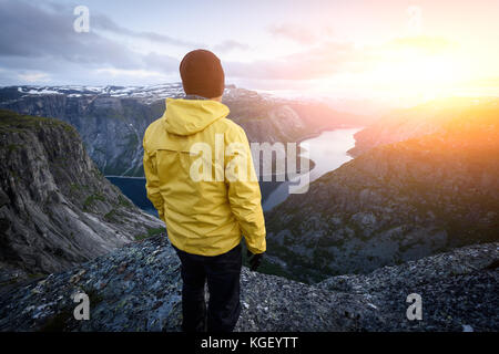 Alone tourist on Trolltunga rock - Stock Photo