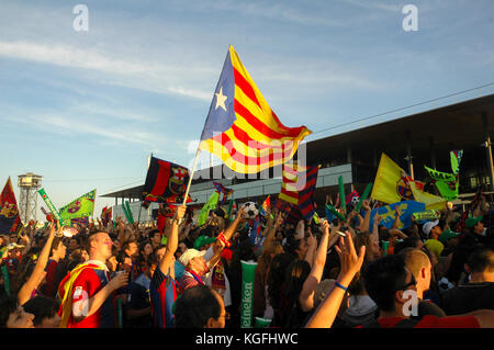 Fans of Barcelona football club celebrating in Barcelona during a game of their team. - Stock Photo