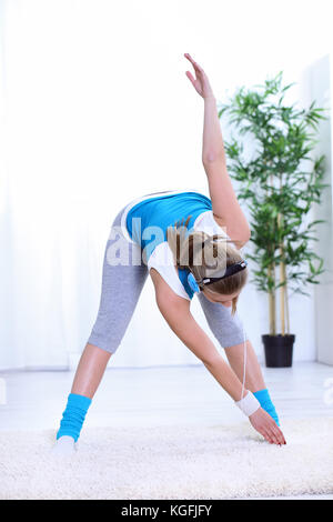 young woman doing gymnastics wearing a gym leotard and