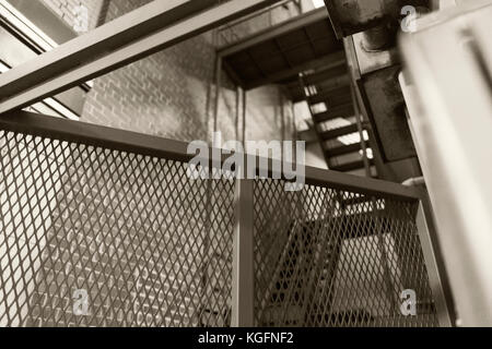 Stairwill And Ladders In An Alley Downtown - Stock Photo