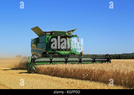 SALO, FINLAND - AUGUST 22, 2015: John Deere Combine s670i harvests barley at Puontin Peltopaivat Agricultural Harvesting - Stock Photo