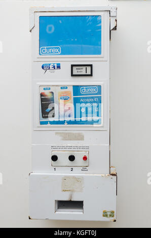 A wall-mounted Durex condom vending machine in public toilets on Hoe Road, Plymouth, UK - Stock Photo