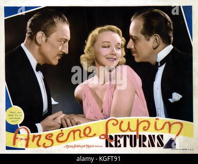 ARSENE LUPIN RETURNS 1938 MGM film with from left: Melvyn Douglas, Virginia Bruce, Warren William - Stock Photo
