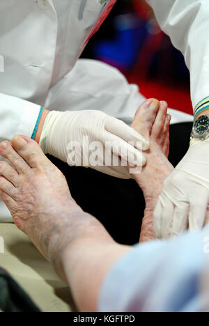 Foot exam of patient with diabetes - Stock Photo