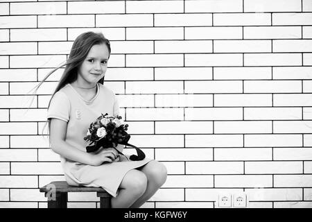 little girl on a chair black and white - Stock Photo