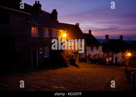 Gold Hill is a steep cobbled street in the town of Shaftesbury in the English county of Dorset - Stock Photo