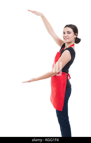 Supermarket woman employee showing and presenting something between her palms with copyspace - Stock Photo