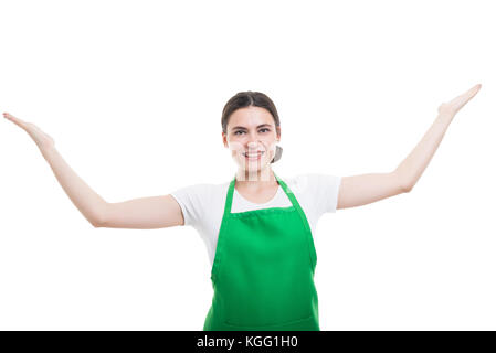 Cheerful girl employer holding arms up or presenting something with copy space - Stock Photo