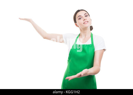 Pretty supermarket seller inviting you to come in or showing something on white background - Stock Photo