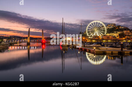 Torquay Harbour and wheel at twilight. - Stock Photo