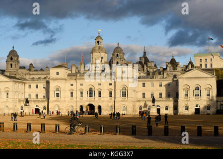 Horse Guards Parade late in the afternoon reddened by the low sun. London. Tourists. Cyclist. Parade ground. Iconic - Stock Photo