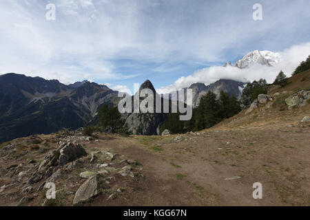 Amazing panorama of a mountain top, glaciers and forests around the Mont Blanc mountain range in Europe - Italy, - Stock Photo