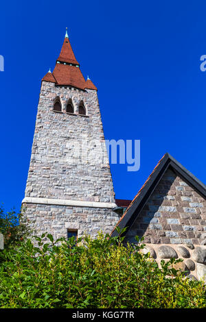 The tower of the cathedral in Tampere with a tiled roof. Finland - Stock Photo