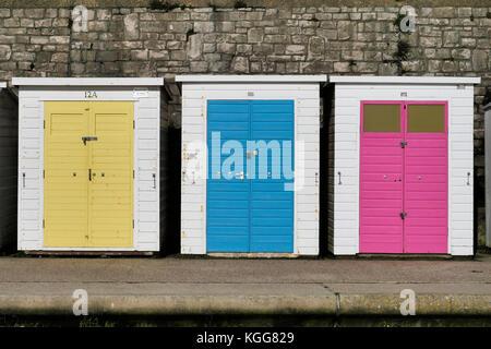 Row of beach huts at Lyme Regis in Dorset. - Stock Photo