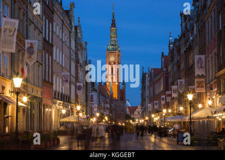 View of the Main Town Hall and tourists and local people strolling on the Long Lane at the Main Town (Old Town) - Stock Photo