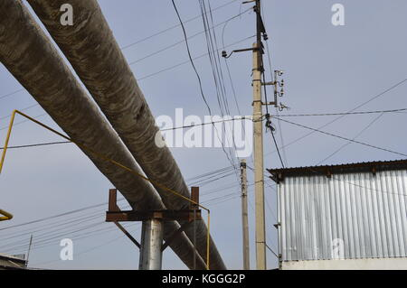 Gas pipelines, electrical wiring and other public utilities spread over all the ex Soviet countries, Kazkahstan. - Stock Photo