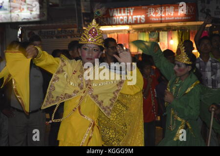 Girls in yellow dress and green dress dancing on the street at Nepalese news year's eve in April, Phokara, Nepal. - Stock Photo