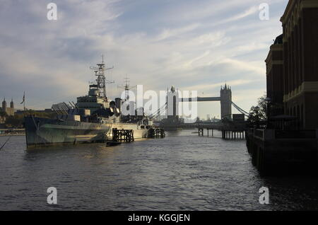 The Tower Bridge and the HMS Belfast ship from the riverside - Stock Photo