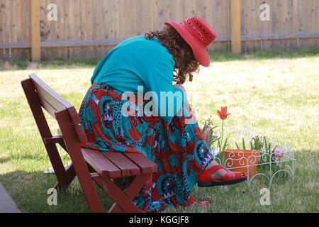 Woman Sitting on a bench - Stock Photo