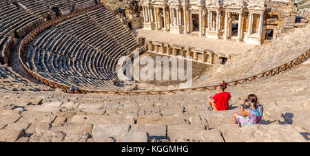 People visit The ruins of Antique Theater in ancient Greek city Hierapolis, Pamukkale, Turkey.25 August,2017 - Stock Photo