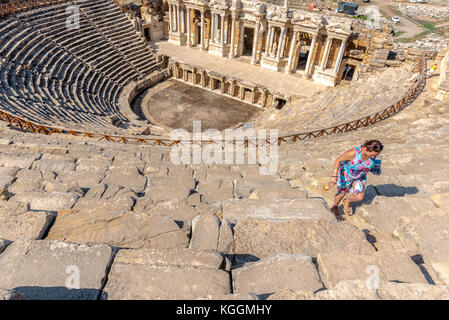 People visit The ruins of Antique Theater in ancient Greek city Hierapolis, Pamukkale, Turkey.25 August 2017 - Stock Photo