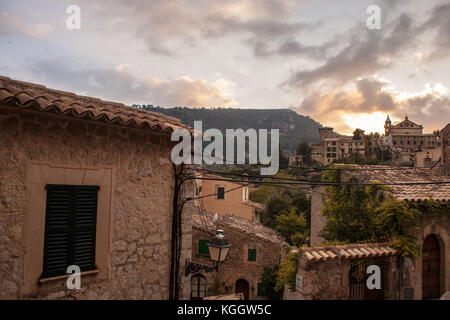 Roofs and telephone cables during a dramatic sunset in Valldemossa, Mallorca - Stock Photo