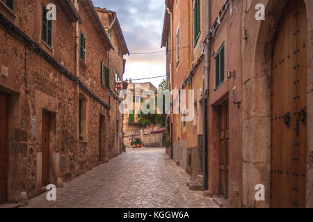 Charming Spanish homes line the street in Valldemossa, Mallorca - Stock Photo