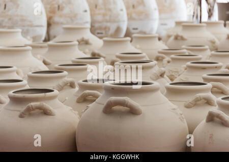 Rows of clay pots drying near a kiln in Vietnam - Stock Photo