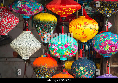 Bright, colorful lanterns in a shop in Southeast Asian village, Hoi An, Vietnam - Stock Photo