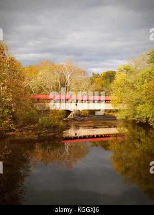 Vertical photograph of the Academia Pomeroy Covered Bridge, across the Tuscarora River in Juniata County, Pennsylvania, - Stock Photo