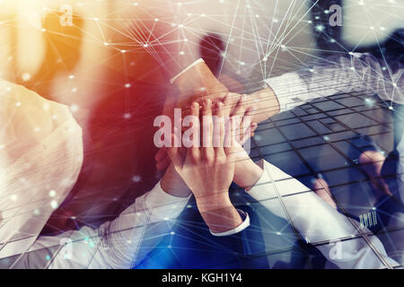 Business people joining hands in the office with network effect. concept of teamwork and partnership. double exposure - Stock Photo